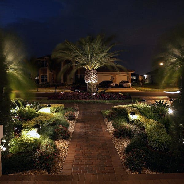 Landscape Lighting Design - What Are The Best Options?With so many advantages offered by a single effective landscape lighting design system, it's no wonder that landscape lighting has steadily become a popular space for homeowners to explore. But while you might possess some basic understanding of general landscape lighting design concepts and techniques, you might still end up with an inefficient and tacky-looking setup. To avoid this sort of disappointment, there are several things that you can do when planning your landscaping lighting plan. These ideas will allow you to ensure that your design concept is truly one of a kind and stands out from the rest. One of the first things that you can do to make sure that you get an outstanding landscape lighting design is to pay attention to how the various components used in your lighting systems are arranged. For instance, you should place long and low lights in places that are far from trees. Doing so will allow you to easily see the tree tops and the foliage that surround them. On the other hand, you should use long and low lights at eye level whenever you're doing general lighting for the entire yard. By doing so, you'll be able to make out the interesting shapes and shadows that are prevalent in your landscape. For example, if there are several potted plants in your yard, try to illuminate them from the front or from the side so that you can see how they look against the backdrop of your landscape. Also, consider using a transformer when it comes to connecting your outdoor lights to your home's electrical system. This is because the transformer will convert the direct current (DC) that your system provides into alternating current (AC). <a href=