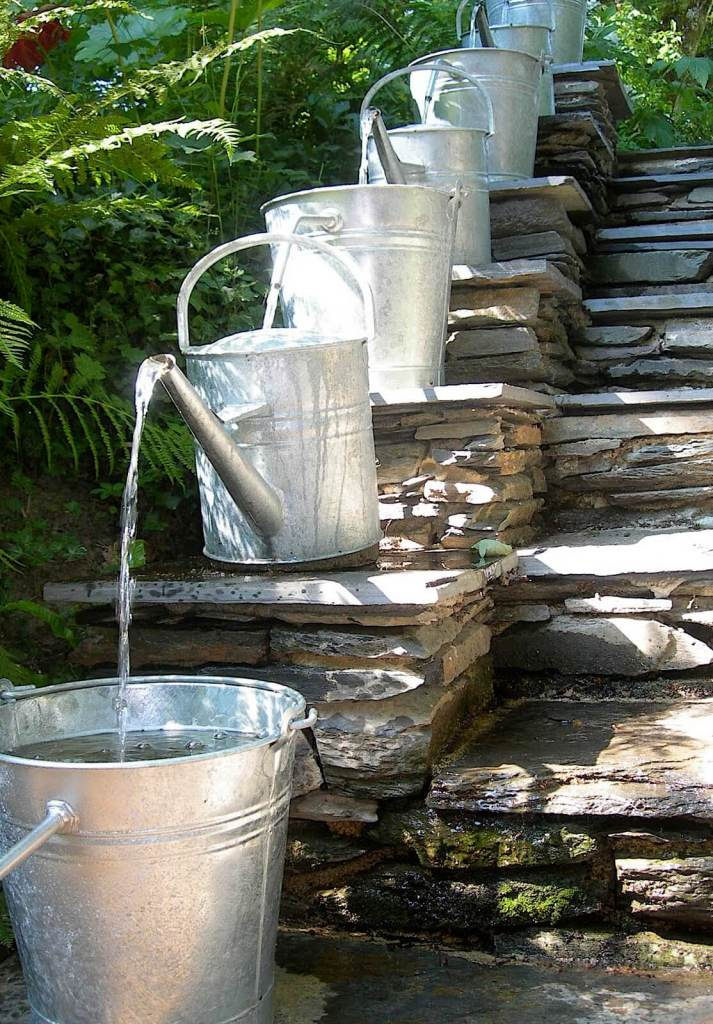 Water feature with watering cans